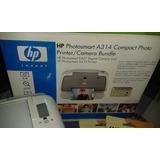Impresora Hp Photosmart A314 Con Una Caja De Papel Fotografi