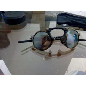 Oakley Triplo X - Óculos De Sol Oakley Com lente polarizada em Belo ... 15ffaf6036