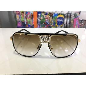 Óculos De Sol Dourado C lente Marrom Lupa Lupa Oakley Oculos ... 2bf258e093