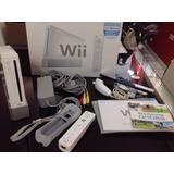 Nintendo Wii + Wii Fit + Wii Sports Resort + U Draw Studio