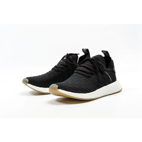 zapatillas adidas negras con rayas blancas