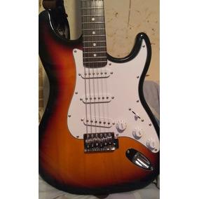 Guitarra+funda+pedales+ Fuente