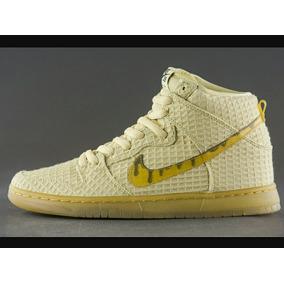 zapatillas nike doradas botitas