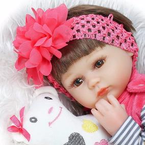Boneca Bebe Reborn Rosa Shock Realista 42cm Silicone E Pano