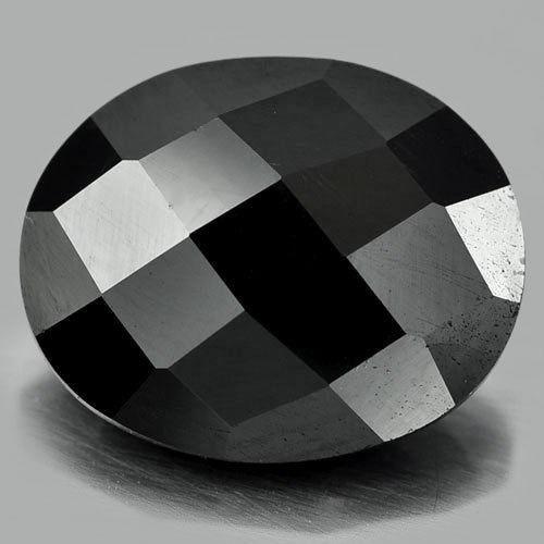 Espinela Negra y Gemas de Circón Blanco