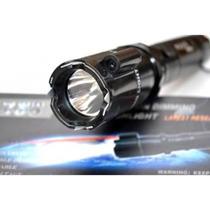Lámpara Toques Taser Stun Gun Descarga Eléctrica Láser