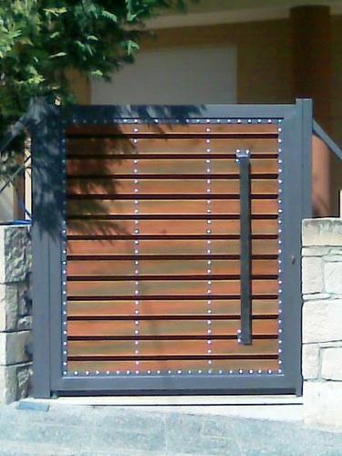 Portones hierro y madera tratada en mercado libre for Puertas de madera con herreria