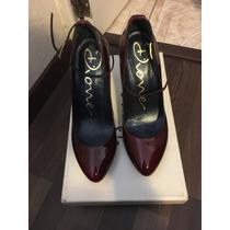 Hermosas Zapatillas Marca Dione Color Vino