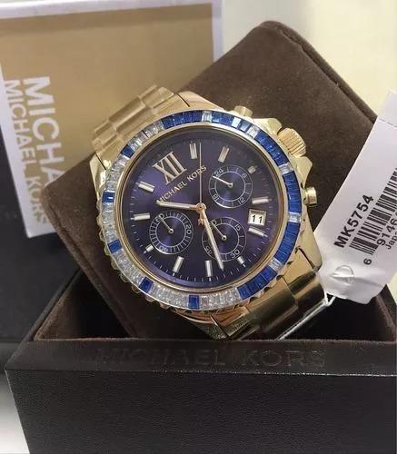 8c6b4ce8db5fc Relógio Michael Kors Mk5754 Dourado Azul Novo Caixa Mk2833 - R  578,08 em  Mercado Livre