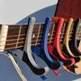 Capotraste De Pinza Guitar Capo Guitarra Cuatro
