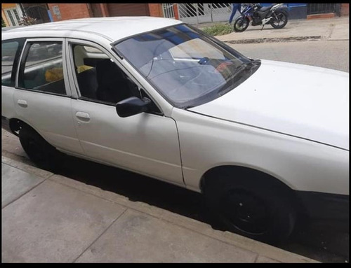 ad 1992 nissan station wagon blanco