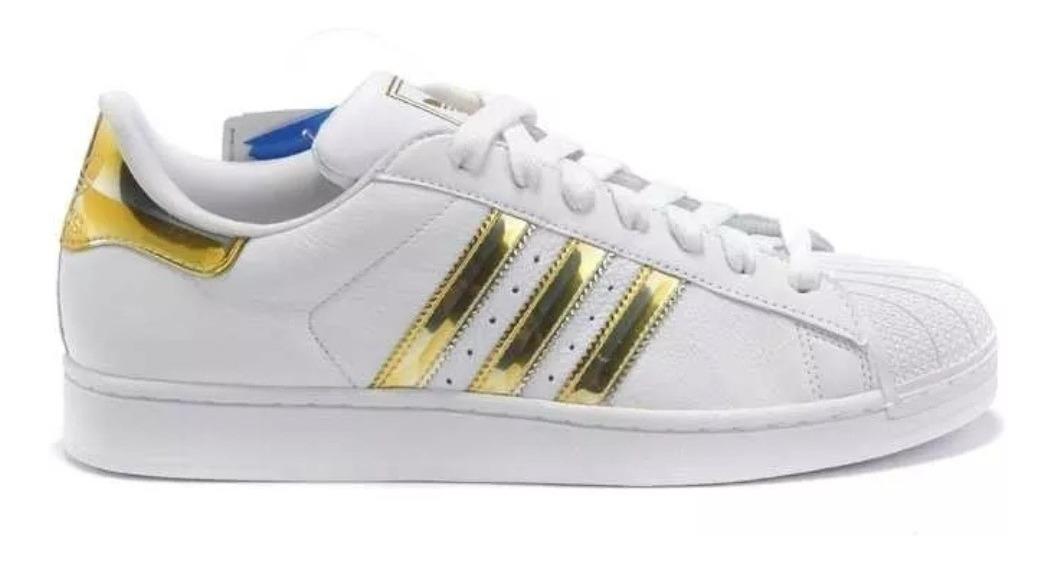 adidas superstar blancas y doradas