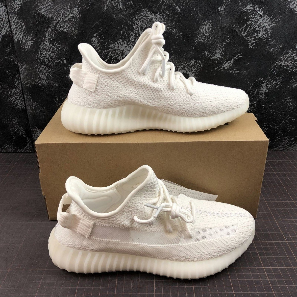cheap for discount b395f effe6 adidas Yeezy Boost 350 V2 Triple White