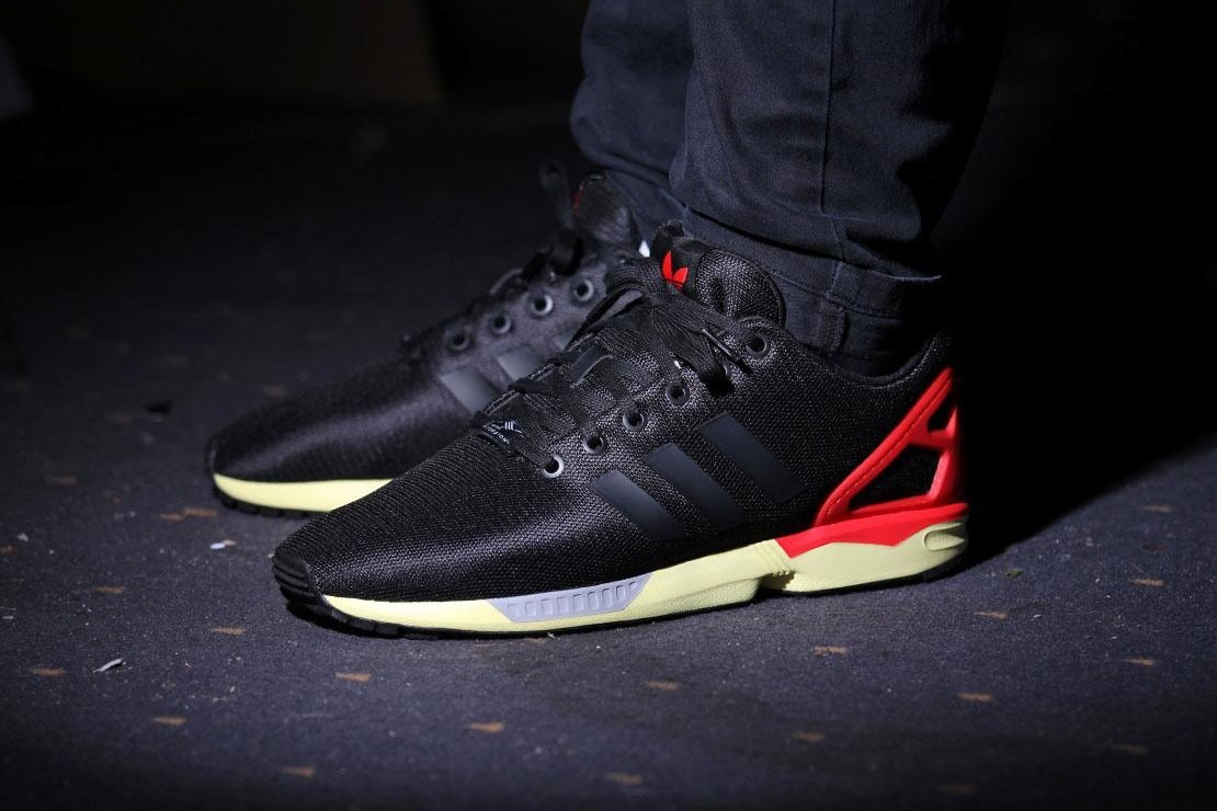f80ff5e98d49f ... coupon code for adidas zx flux trainers core black red yellow b34135.  cargando zoom.