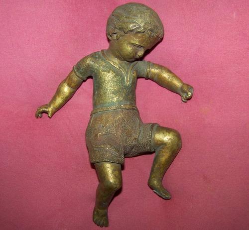 adorno antiguo un niño acostado para decoracion
