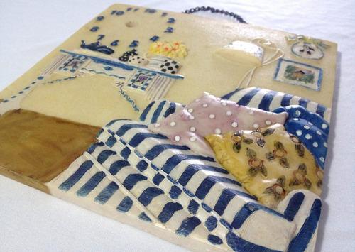 adorno de ceramica miró colgable. u1