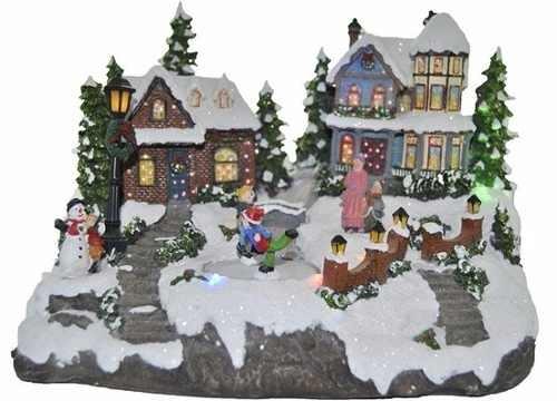 adorno navideño casa con luz y niño esquiando