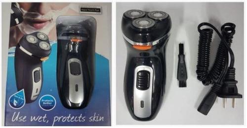 afeitadora eléctrica sumergible al agua recargable at-882