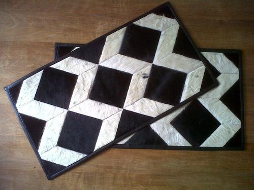 alfombra pie cama de cuero de vaca con pelo blanco y negro