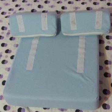 almohada antivuelco recién nacido con protectores laterales