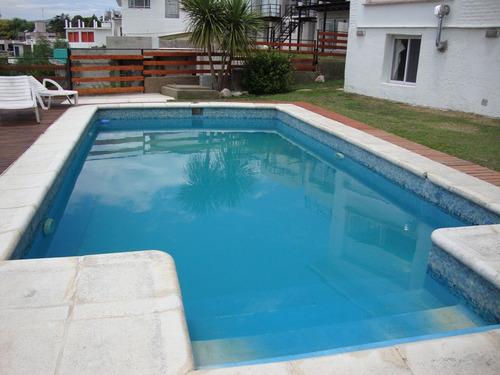 amplia casa en villa carlos paz, fondo al lago, pileta,wi-fi