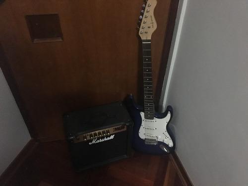 amplificador marshall mg15 y guitarra eléctrica