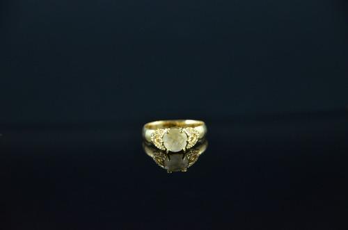 anel lapidado cristal rutilado com cravação de zircônias