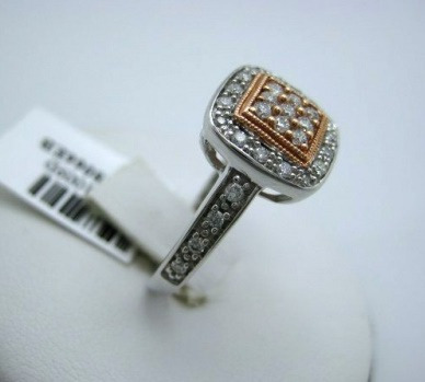 anel  ouro branco e rosê com   brilhantes de 1 ponto!!