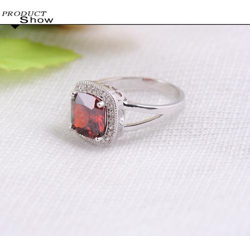 anel oval pedra vermelha