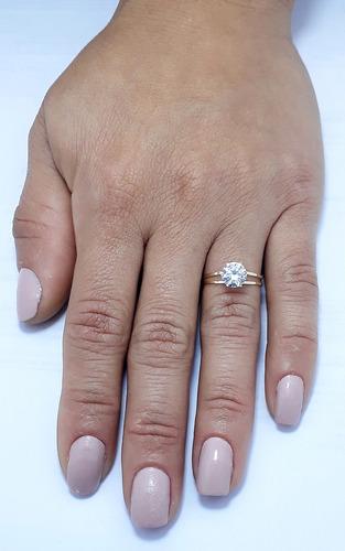 anel solitário feminino ouro 18k .