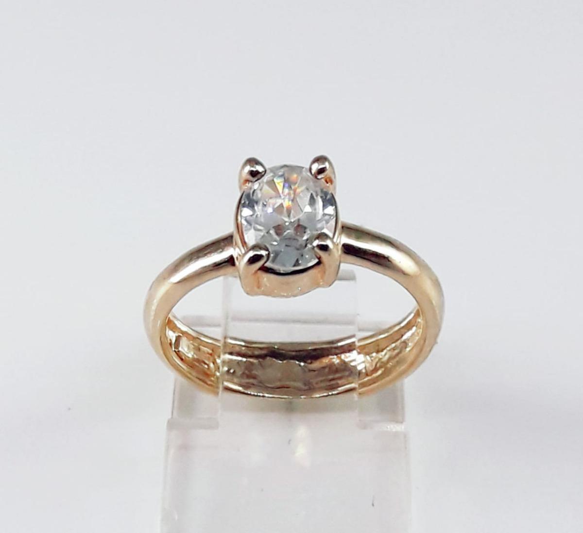 e9a33a203a18d anel solitário folhedo à ouro com pedra oval. Carregando zoom.