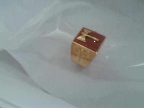 anel xangô com três oxês e pedra marrom