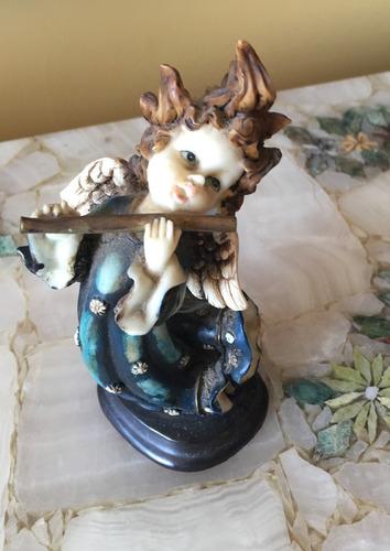 ángel flautista