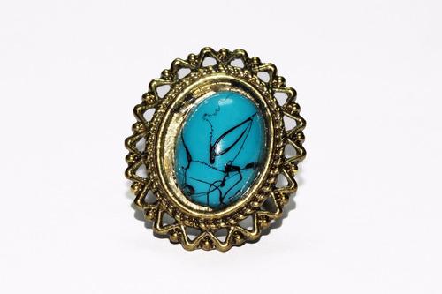 anillo acero dorado flor centro azul ase450