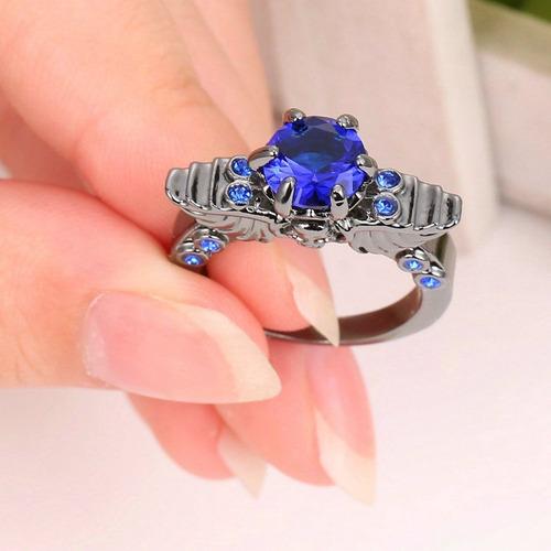 anillo acero negro calavera piedras circon azul