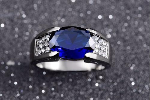 anillo clasico acero negro bañado piedras azul