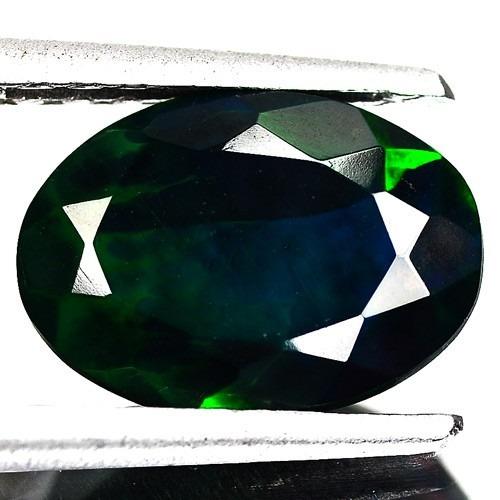 anillo con opalo natural negro de .86 ct.