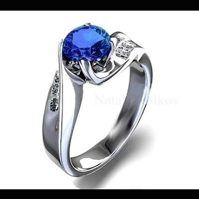 Anillo compromiso zafiro diamantes