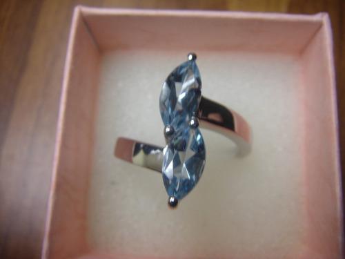 anillo de plata y topacios
