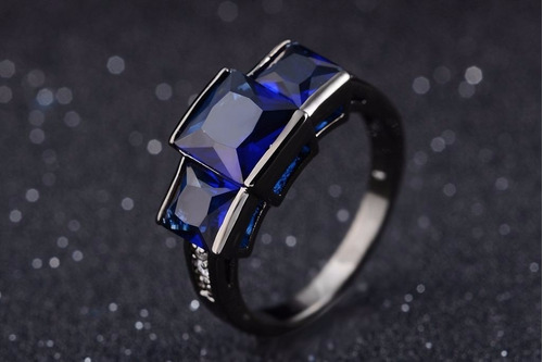 anillo negro piedra azul