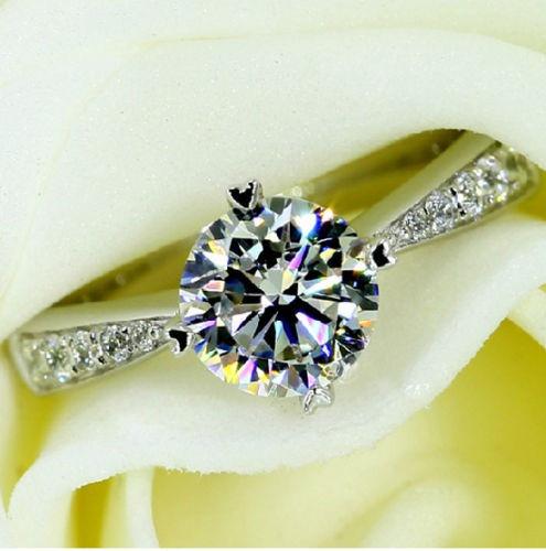 anillo solitario topacio bco y acentos  zirconia c2 talla 7