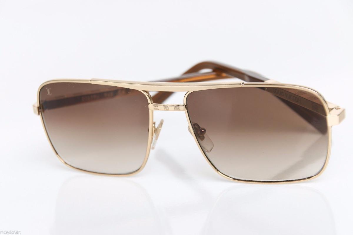 29fa3e372c3d3 anteojos de sol louis vuitton actitud oro y plata. Cargando zoom.