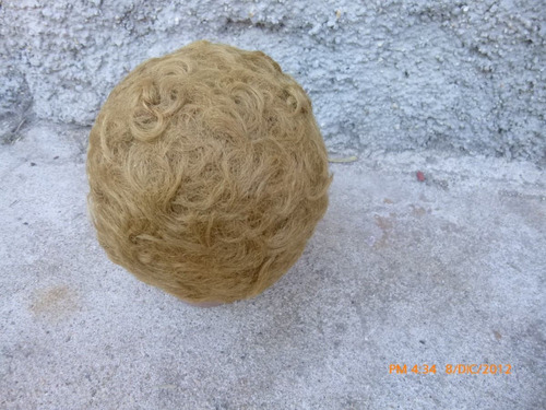 antigua cabeza de muñeca de goma