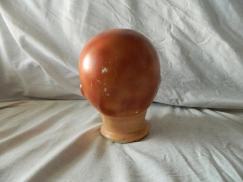 antigua cabeza de muñeca de yeso