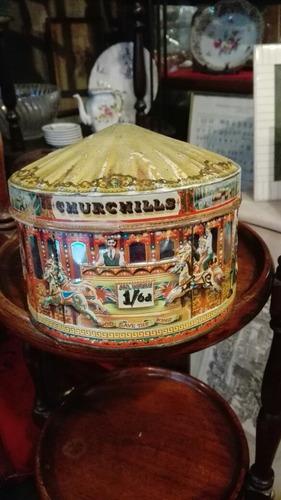 antigua lata de caramelos  churchills en forma de calesita