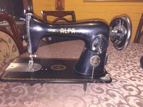 antigua maquina de cocer marca alfa