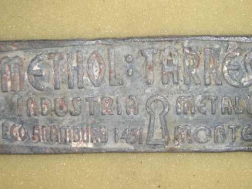 antigua placa en plomo con publicidad mide 23x6 cms.