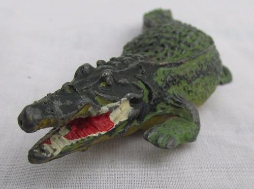 antiguo cocodrilo de plomo, ind. argentina, a restaurar