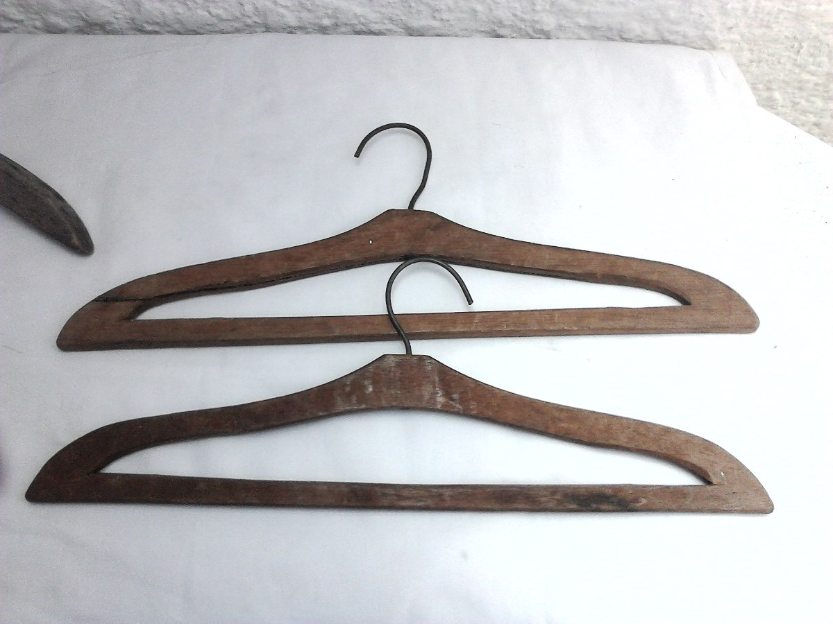 antiguos ganchos para colgar ropa en madera en