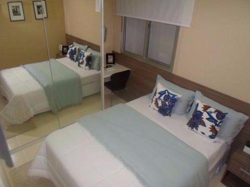 apartamento 2 quartos,churrasqueira,piscina e area de lazer.